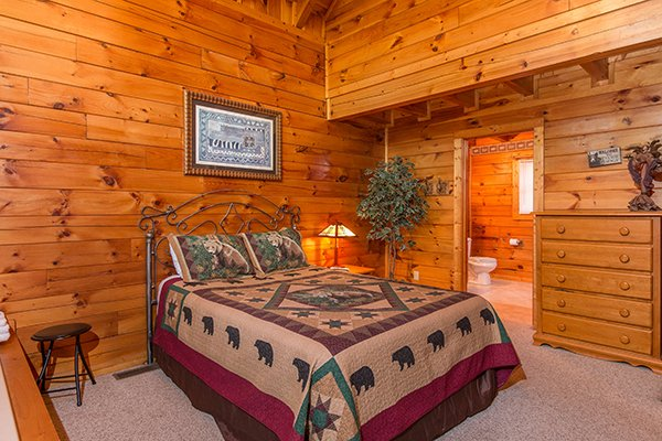 bedroom with dresser at a honeymoon haven a 1 bedroom cabin rental located in gatlinburg