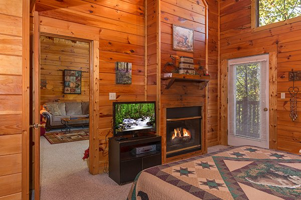 fireplace and television in a bedroom at a honeymoon haven a 1 bedroom cabin rental located in gatlinburg