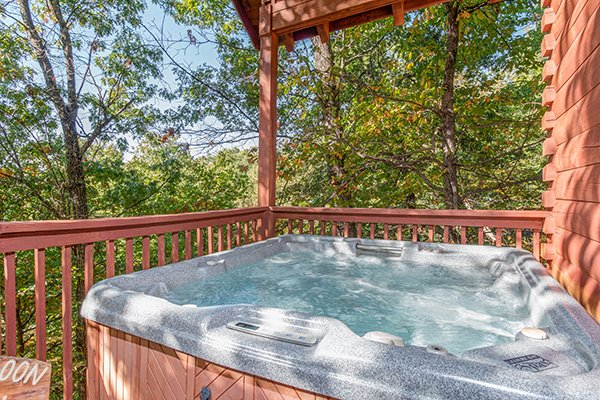 Hot tub on a deck at A Honeymoon Haven, a 1 bedroom cabin rental located in Gatlinburg