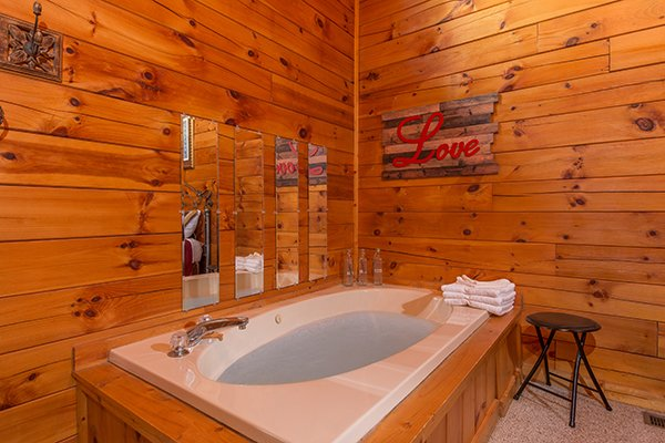 jacuzzi tub at a honeymoon haven a 1 bedroom cabin rental located in gatlinburg
