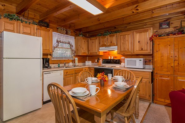 Kitchen and dining room at A Honeymoon Haven, a 1 bedroom cabin rental located in Gatlinburg