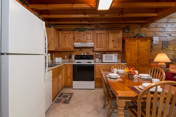 Kitchen and dining table for four at A Honeymoon Haven, a 1 bedroom cabin rental located in Gatlinburg