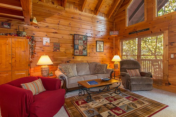 living room with couch and two large chairs at a honeymoon haven a 1 bedroom cabin rental located in gatlinburg