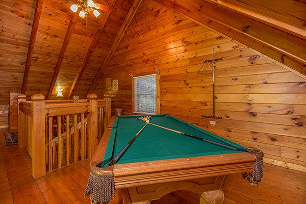 Pool table in a loft at A Honeymoon Haven, a 1 bedroom cabin rental located in Gatlinburg