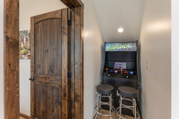 Arcade game at Mountain Celebration, a 4 bedroom cabin rental located in Gatlinburg