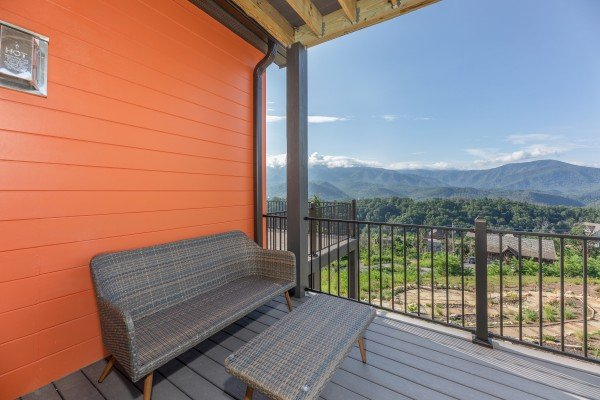 Deck seating off the bedroom at Mountain Celebration, a 4 bedroom cabin rental located in Gatlinburg