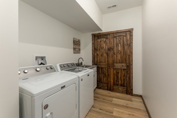 Laundry room with utility sink at Mountain Celebration, a 4 bedroom cabin rental located in Gatlinburg