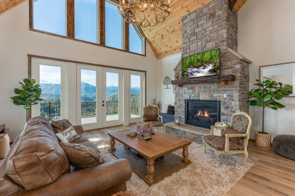 Living room with mountain view, fireplace, and TV at Mountain Celebration, a 4 bedroom cabin rental located in Gatlinburg