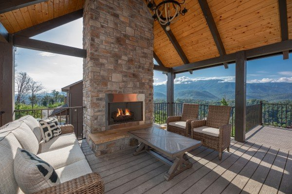 Outdoor fireplace at Mountain Celebration, a 4 bedroom cabin rental located in Gatlinburg