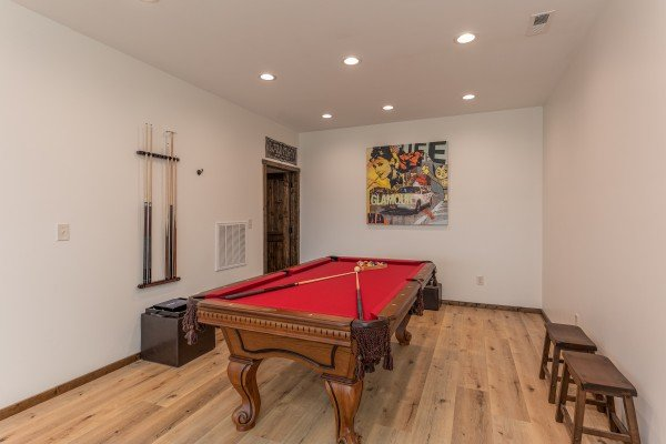 Pool table in a game room at Mountain Celebration, a 4 bedroom cabin rental located in Gatlinburg