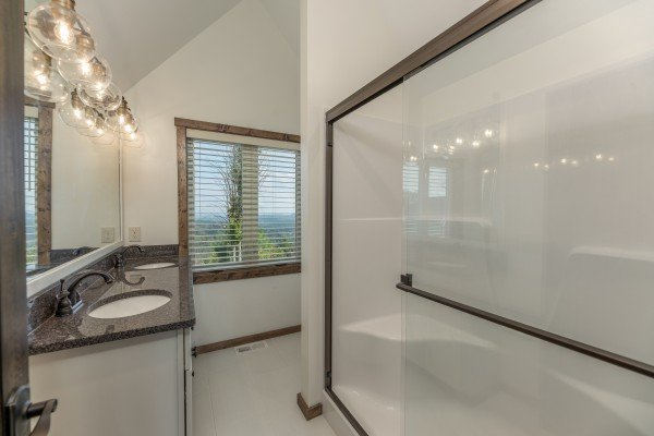 Bathroom with walk in shower at Mountain Celebration, a 4 bedroom cabin rental located in Gatlinburg