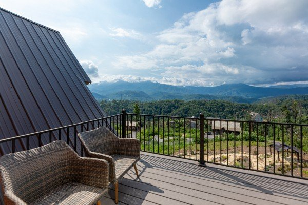 Deck with two chairs at Mountain Celebration, a 4 bedroom cabin rental located in Gatlinburg