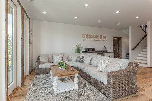 Large sectional sofa in the lower living room at Mountain Celebration, a 4 bedroom cabin rental located in Gatlinburg