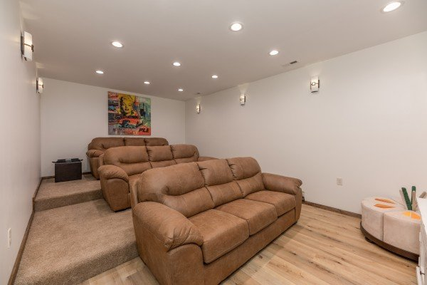 Theater room with sofa seating at Mountain Celebration, a 4 bedroom cabin rental located in Gatlinburg