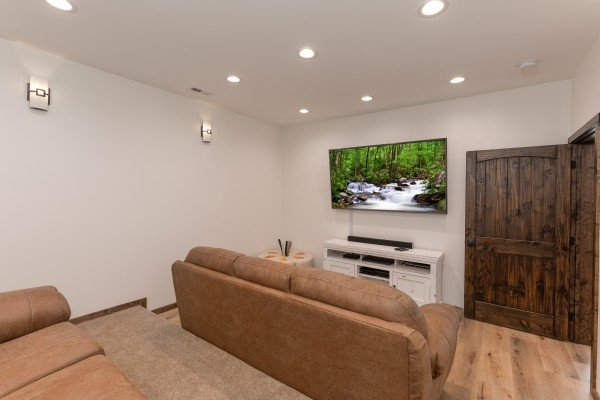 TV in the theater room at Mountain Celebration, a 4 bedroom cabin rental located in Gatlinburg