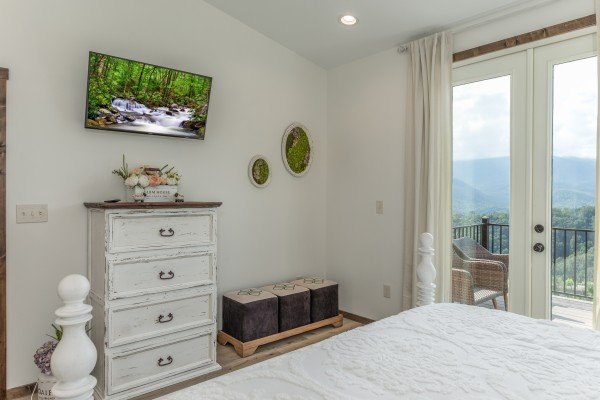 Dresser and TV in a bedroom at Mountain Celebration, a 4 bedroom cabin rental located in Gatlinburg