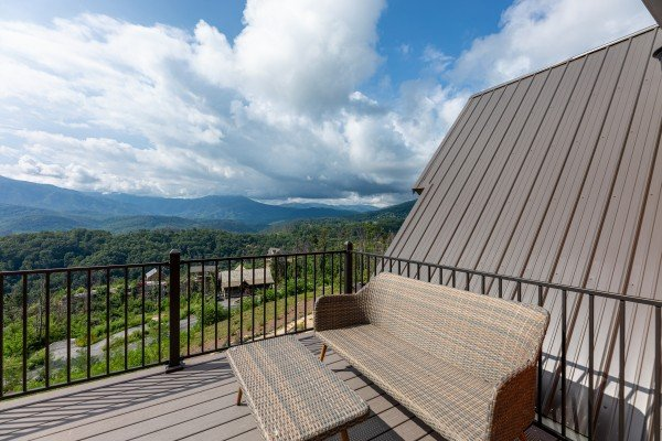 Seating on the upper deck at Mountain Celebration, a 4 bedroom cabin rental located in Gatlinburg