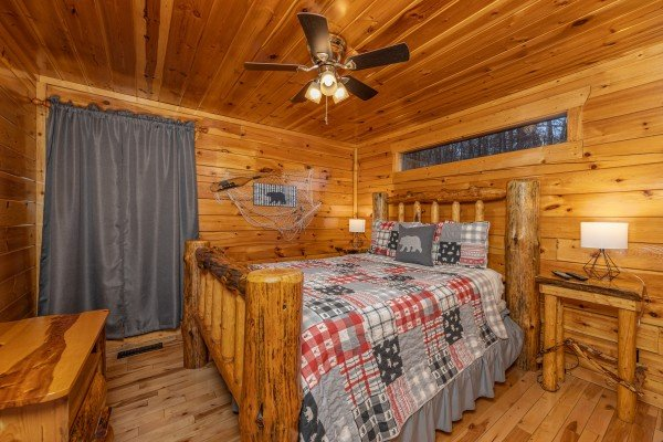 Bedroom with a log bed, night stands and lamps at A Bear on the Ridge, a 2 bedroom cabin rental located in Pigeon Forge