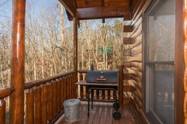 Grill on the covered deck at A Bear on the Ridge, a 2 bedroom cabin rental located in Pigeon Forge
