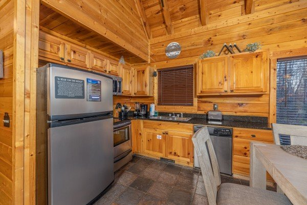 Kitchen with stainless steel appliances A Bear on the Ridge, a 2 bedroom cabin rental located in Pigeon Forge