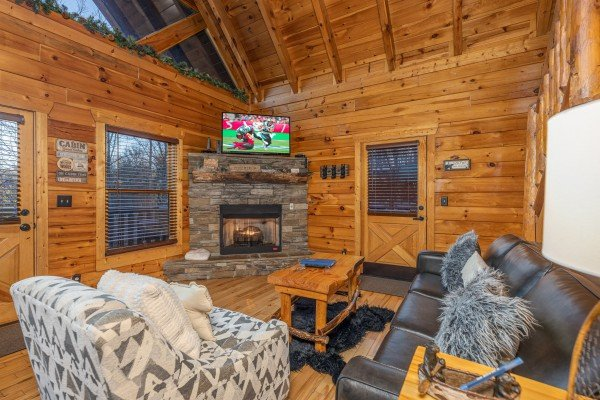 Fireplace and TV in a living room A Bear on the Ridge, a 2 bedroom cabin rental located in Pigeon Forge