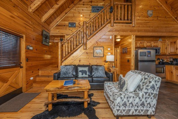 Chair and sofa in a living room A Bear on the Ridge, a 2 bedroom cabin rental located in Pigeon Forge