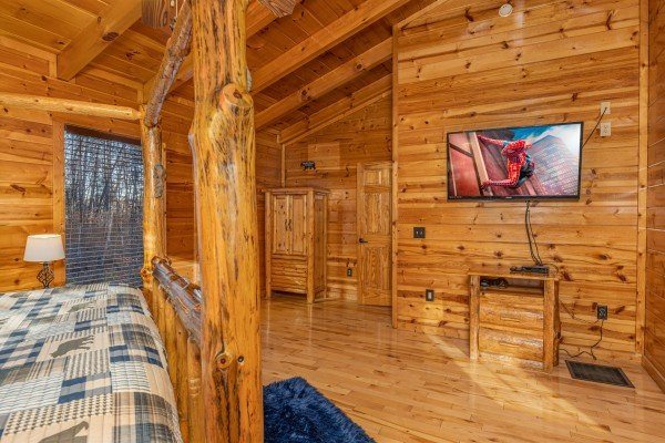 TV and night stand in a bedroom at A Bear on the Ridge, a 2 bedroom cabin rental located in Pigeon Forge