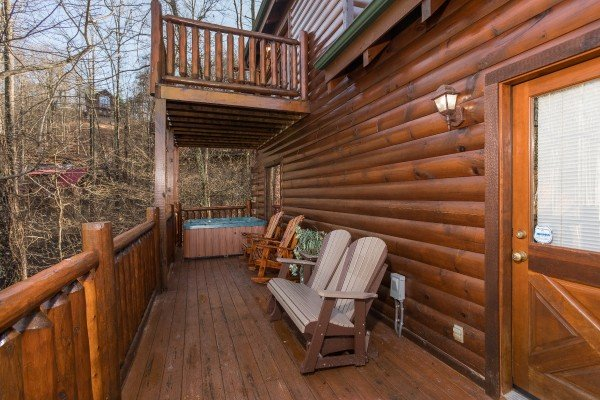 Deck chairs and hot tub at A Bear on the Ridge, a 2 bedroom cabin rental located in Pigeon Forge