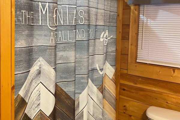 Mountain shower curtain at A Bear on the Ridge, a 2 bedroom cabin rental located in Pigeon Forge