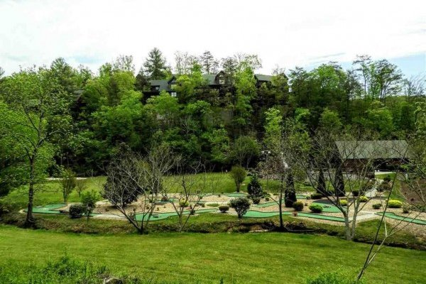 Landscaping and putt putt course at Bearfoot Memories, a 2-bedroom cabin rental located in Pigeon Forge