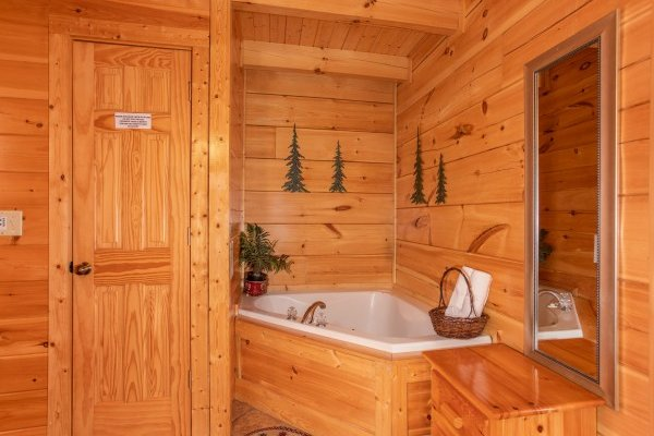 Corner jacuzzi tub at Bearfoot Memories, a 2-bedroom cabin rental located in Pigeon Forge