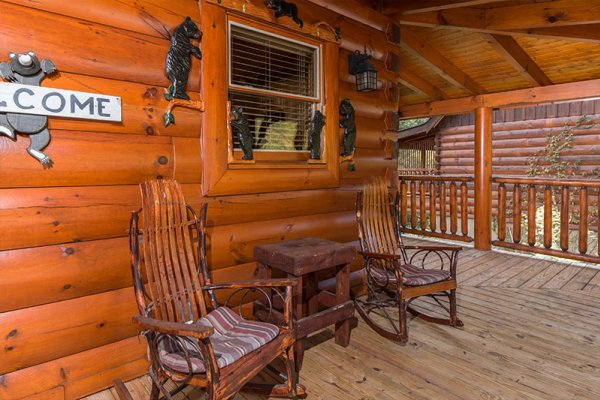 Rocking chairs on the front porch at Bearfoot Memories, a 2-bedroom cabin rental located in Pigeon Forge