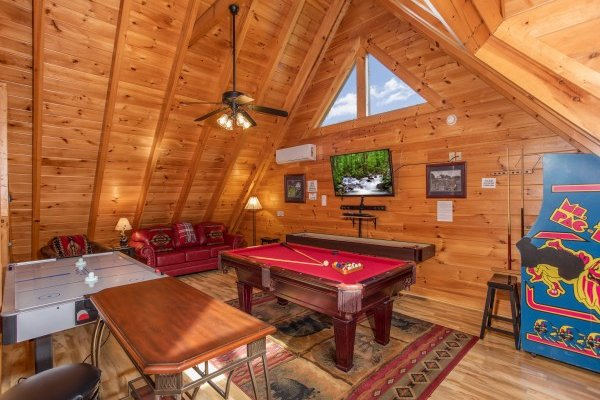 Game loft at Bearfoot Memories, a 2-bedroom cabin rental located in Pigeon Forge
