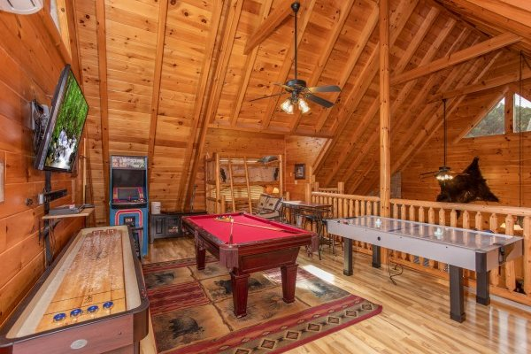 Game room loft at Bearfoot Memories, a 2-bedroom cabin rental located in Pigeon Forge