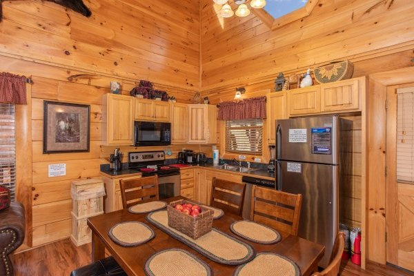 Dining area with seating for six in the kitchen at Bearfoot Memories, a 2-bedroom cabin rental located in Pigeon Forge