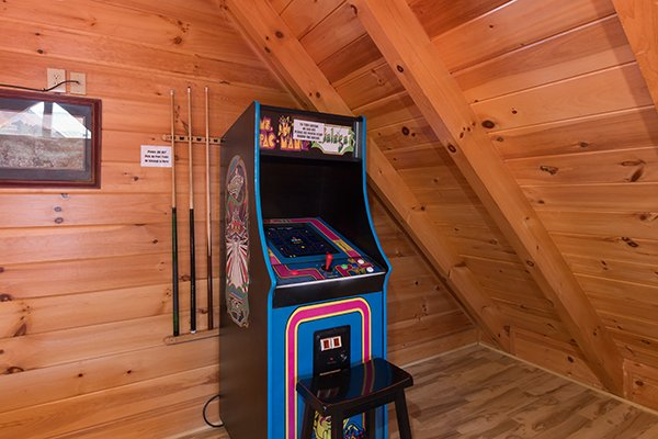 Arcade game at Bearfoot Memories, a 2-bedroom cabin rental located in Pigeon Forge