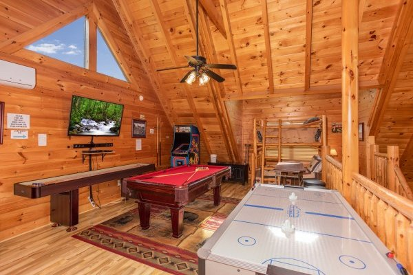 Air hockey table, pool table, and shuffle board at Bearfoot Memories, a 2-bedroom cabin rental located in Pigeon Forge