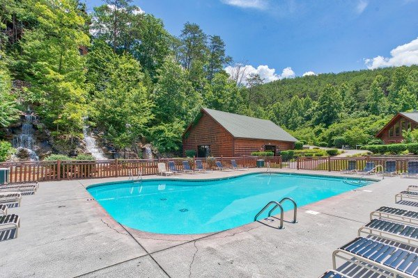 Outdoor pool at Bearfoot Memories, a 2-bedroom cabin rental located in Pigeon Forge