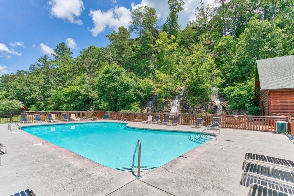 Resort outdoor pool at Bearfoot Memories, a 2-bedroom cabin rental located in Pigeon Forge