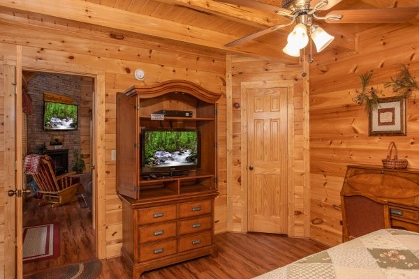Armoire with television at Bearfoot Memories, a 2-bedroom cabin rental located in Pigeon Forge