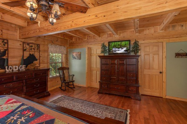 Armoire and tv in the main floor bedroom at Mystic Ridge, a 4 bedroom cabin rental located in Pigeon Forge