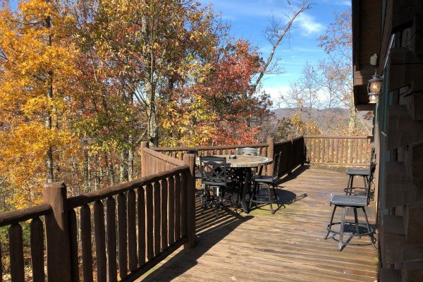 Deck dining in the fall at Mystic Ridge, a 4 bedroom Pigeon Forge cabin rental