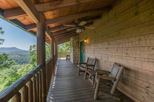 Rocking chairs on the covered deck at Mystic Ridge, a 4 bedroom cabin rental located in Pigeon Forge