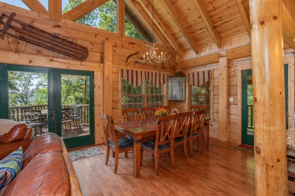 Dining table for eight at Mystic Ridge, a 4 bedroom cabin rental located in Pigeon Forge