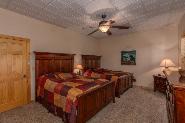 Bedroom with two queen beds on the lower level at Mystic Ridge, a 4 bedroom cabin rental located in Pigeon Forge