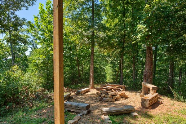 Fire pit with multiple benches at Mystic Ridge, a 4 bedroom cabin rental located in Pigeon Forge
