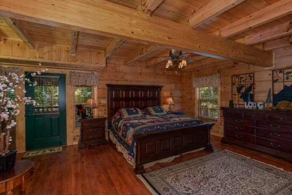 Bedroom with a king sized bed on the main floor at Mystic Ridge, a 4 bedroom cabin rental located in Pigeon Forge