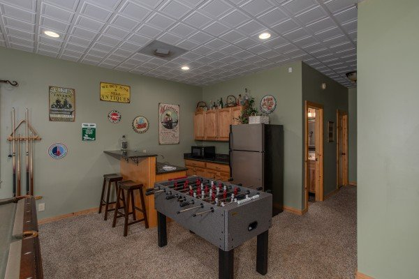 Foosball table and kitchenette on the lower level at Mystic Ridge, a 4 bedroom cabin rental located in Pigeon Forge
