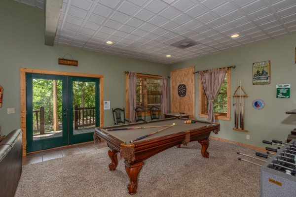 Game room on the lower level at Mystic Ridge, a 4 bedroom cabin rental located in Pigeon Forge