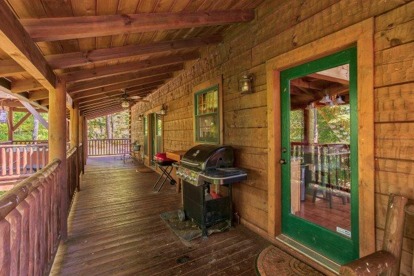 Grill on the covered deck at Mystic Ridge, a 4 bedroom cabin rental located in Pigeon Forge